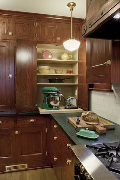 Craftsman kitchen with pull-out shelf for mixer -- house remodeled by Craftsman Design & Renovation