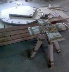 un-assembled spider table