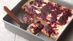 Classic raspberry swirl cheesecake bars meet the refreshing citrus twist of lemon peel in these decadent cookie bars you'll want to make again and again.