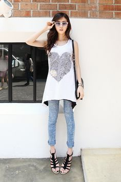 Wearing an oversized printed top she displays a classic ulzzang Korean look.  -Lily. #koreanfashion