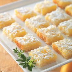 Lemon Coconut Squares ~ The tangy lemon flavor of this no-fuss bar dessert is especially delicious on a warm day. After baking, let cool for about 7 minutes and cut into squares. Don't wait longer or it's difficult to remove from baking pan! They disappear quick!