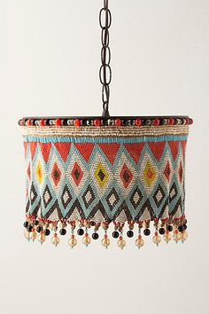 KIRDI PENDANT LAMP inspired by intricately beaded aprons worn by women in farming communities of certain countries in central Africa. Motifs denote social status within the tribe. No two are exactly alike.