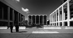 Central view of the Lincoln Center for the Performing Arts in NYC by Hagen Stier.  Showing here to the left is the David H. Koch theatre (aka the New York State Theatre) designed by Philip Johnson, In the center the magnificent Metropolitan Opera House by Wallace Harrison and to the right the Avery Fisher Hall by Max Abramovitz.