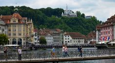 LUCERNE, Switzerland: Another bridge and view of old hotel over the river Reuss in Aldstadt Luzern
