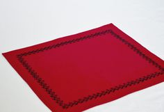 Red placemats with jet black embroidery  Handmade by AmoreBeaute, $36.00