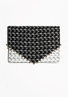 Statement-making with a pinch of whimsy, this large quilted clutch in our geometrical polka dot check print has a soft padded feel and is finished with gold-tone beads around the flap for an elevated festive look.