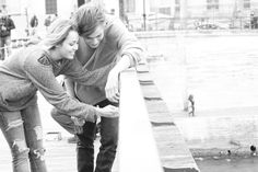 Miley Cyrus and Douglas Booth placing a love padlock in Paris