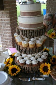 Cute idea to have platforms for cupcakes and the cake on top. Makes it look like a tall wedding cake with an easy option for guests to grab a cupcake. Western Wedding Cakes, Country Wedding Cakes, Camo Wedding, Unique Wedding Cakes, Vineyard Wedding, Trendy Wedding, Rustic Wedding, Our Wedding, Dream Wedding