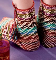 Love these .... on the blog site whipup.net however they are a pattern in the lovely book 'Around the World in Knitted Socks', 26 Inspired Designs Stephanie van der Linden. 2010 Interweave Press
