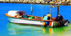 Small Wooden Boat Moored On Front Street Beach Love's Photo Album