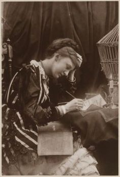 A lady writing and reading circa 1800s