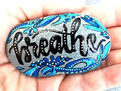 A personal favorite from my Etsy shop https://www.etsy.com/listing/475847377/breathe-painted-rocks-painted-stones