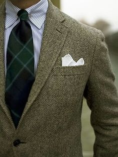 Light grey tweed jacket, white shirt with blue dress stripes, black watch plaid tie