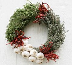 The Culinary Garlic and Herbs Wreath will fill a home with fresh aromas and makes a very special one-of-a-kind gift during the holidays.