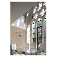 my dream house would be to convert an old church!! Modern dining room in converted church