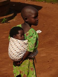 Big sister taking care of little sister, Ugandan style :)