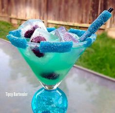The Blue Dream: 1 1/4 oz blue raspberry punch candy infused vodka, 1/4 oz blue curacao, 1/4 oz lime juice, 1/2 oz sweet & sour, 1/2 oz white cranberry juice, Blackberry infused ice cubes, and sour punch candies on rim and straw