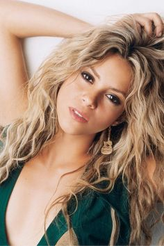 Shakira beauty wit long curly signature hair.