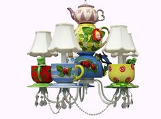The whimsical characters of Alice in Wonderland join your kid's room with this gorgeous chandelier by Louise Antoinette. Your kid's room will turn into the Mad Hatter's Tea Party with the flip of a switch!