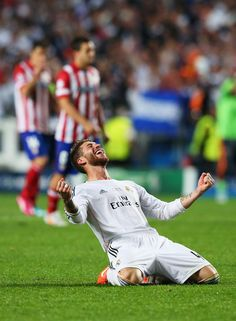Sergio Ramos celebrates victory after the UEFA Champions League final match between Real Madrid CF and Club Atlético de Madrid at Estadio Da Luz on May 24, 2014 in Lisbon, Portugal.