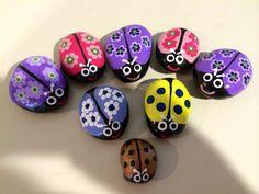 Lady bugs painted on rocks by Linda Hallett.