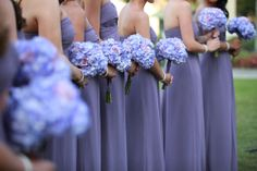 Soft lavender tones for the bridesmaids, with bouquets of hydrangea and roses.  Image by Tab McCausland