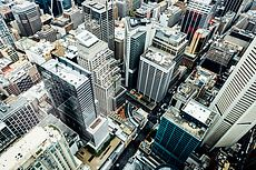 Aerial view of city skyscrapers from above. Architecture gallery by Trent Lanz for Stocksy United - Royalty-Free Stock Photos. aerial, architecture, australia, building, business centre, centre, city, cityscape, country, day, daylight, downtown, from above, high, horizon, horizontal, metropolis, modern, nobody, outdoors, roof top, rooftop, scenery, season, sightseeing, skyscraper, summer, tourism, town, travel, travelling, trip, urban, view
