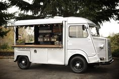A 1972 restored Citroën H Van used as Union Wine Company's roving wine tasting truck with a wooden counter.