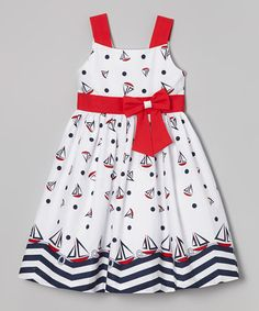 White & Red Bow Sash Sailboat Dress - Girls  Ahoy matey! Little sweeties can set sail in style wearing this nautical piece. Its playful print and bow-adorned silhouette create a classic sea-worthy look.