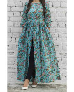 Shop online Aqua burst cape Aqua green block printed malmal cape with boat neckline and lining in the bodice Frock Fashion, Hijab Fashion, Fashion Dresses, Indian Designer Outfits, Designer Dresses, Stylish Dresses, Casual Dresses, Maxi Dresses, Hijab Casual