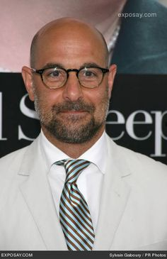7aef601a0e1f3 Stanley Tucci knows how to wear a white shirt. Stripped tie. Shaved Head  With