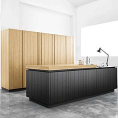 """archiproducts: """"Wood I. by Polaris Life is a project with solid and compact compositional solutions. Doors with vertical staves hide spaces with multiple functions, while the sliding table and the recessing doors for the closet are the result of a..."""