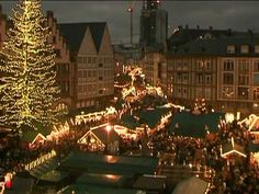 Christmas in Germany one day. Love the homemade crafts and bright lights everywhere.