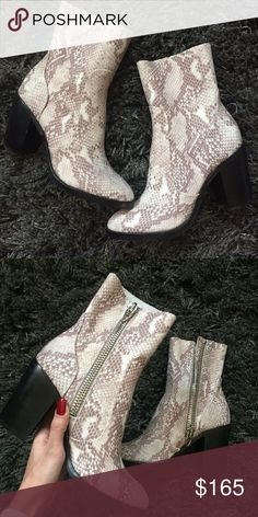 LF Dolce Vita Snakeskin Booties Brand new without box Dolce Vita brand snakeskin booties bought from LF. Size 7 and fits true to size, the material is also a nice soft snakeskin, not the stiff ones... Super comfy and fits really nice ✨ features a light wooden heel LF Shoes Ankle Boots & Booties