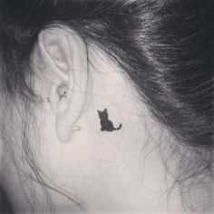 Little black cat tattoo. It's finally on my body. Eeep!