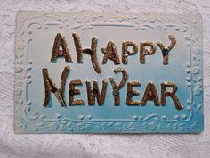 Beautiful antique/Art Nouveau Happy New Year postcard in blue, embossed piece with glitters, rhinestones early 1900s' New Year Postcard, Vintage Buttons, Etsy Shipping, Antique Art, Green And Orange, Vintage Postcards, Happy New, Glitters, Rhinestones