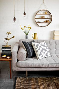 Mid-century modern living room. Love the grey sofa and hanging shelf.