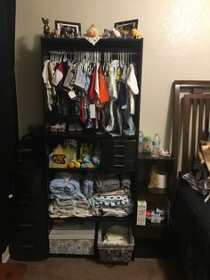 I bought this bookshelf at Wal-Mart and made it into a baby closet! Quite easy! All you have to do is make sure you buy a bookshelf with adjustable dividers and some tension rods. The rest you can do yourself. Bookshelf Closet, Bookshelf Organization, Bookshelves, Nursery Bookshelf, Baby Bedroom, Baby Boy Rooms, Baby Boy Nurseries, Baby Clothes Storage, Baby Storage