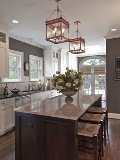 Wall color and contrasting cabinet colors make for an interesting mix in this kitchen....