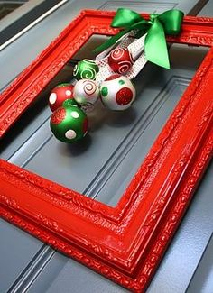 Find old frames at Goodwill, spray paint and add garnish