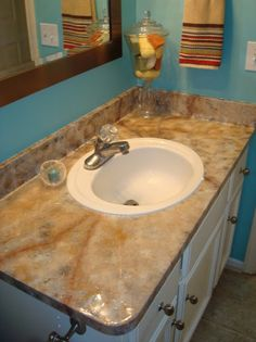 Painting laminate countertops - site has several sets of instructions from different people detailing how they did it.
