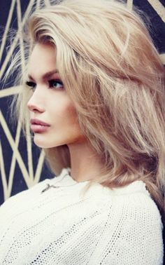 Classic volume hair, full brows, cat eye, and natural full pout.