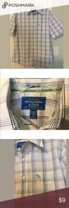 """Abercrombie and Fitch Men's Button Down Shirt Guys Abercrombie Button front shirt. White background with shades of blue in the pattern. It's a muscle cut measuring 46"""" across the chest and 29"""" long. Abercrombie emblem on the front pocket. Everything is shipped clean, pressed from a smoke free environment. Abercrombie & Fitch Shirts Casual Button Down Shirts"""