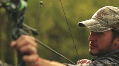Luke Bryan...and his bow. Yum. my dream man even does archery....