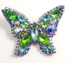 """Vintage Weiss Rhinestone Butterfly Brooch, Blue, Green and AB Stones. Set in silver tone metal. This is an unsigned Weiss piece. Measures 2 1/2"""" across. Very good vintage condition."""