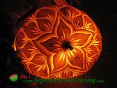 Pumpkin carved with Flower  design. T see more pumpkin lanterns visit http://www.vegetablefruitcarving.com/blog/how-to-make-carved-pumpkin-lanterns/?pid=416