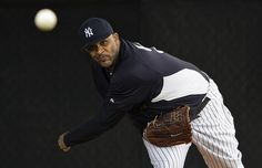 New York Yankees pitcher CC Sabathia throws in the bullpen during a workou