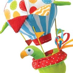 A motion activated multiple textured stroller toy with sound effects and music.Tap the hot air balloon basket for a musical feedback.