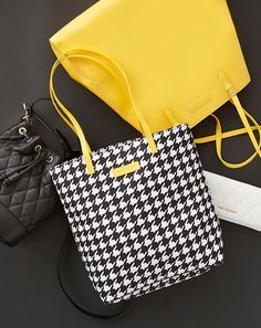 Hello Yellow Tote: The black, white and yellow trend threading its way through our Spring collection was very much inspired by the urban woman on the go, including scenes of taxi cabs and vast black and white cityscapes.