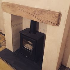 Mendip Loxton 5 stove with oak mantle and slate hearth Oak Mantle, Wood Mantels, Slate Hearth, Building A Cabin, Hearths, Hearth And Home, Wood Burner, Metal Buildings, Tree Houses